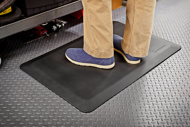SimplyPerfect™ anti-fatigue mat used in a garage.